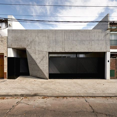 Triangular facets give a folded appearance to the bare concrete facade of this house in Argentina by local architect Nicolás Campodonico