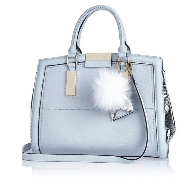 River Island Light blue pom pom handbag (£42) ❤ liked on Polyvore featuring bags, handbags, tote bags, bags / purses, blue, shoppers / tote bags, women, faux leather tote, vegan purses and faux leather tote bag