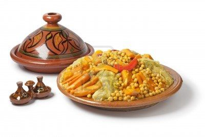 Traditional Moroccan dish with couscous on white background