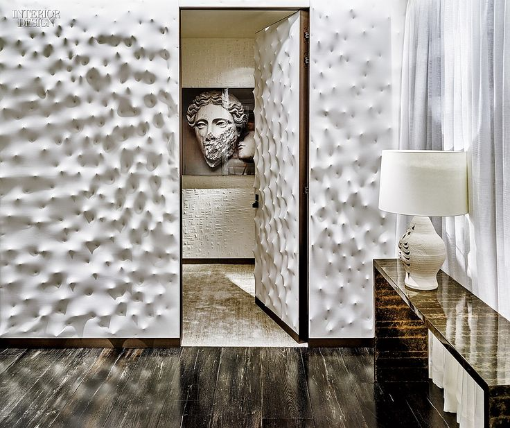 Fendi's Flagship by Peter Marino Brings Italy to Midtown | For the outer walls and door of a fitting room, canvas was stretched over pointed rods. Inside hangs a photograph by Mimmo Jodice.