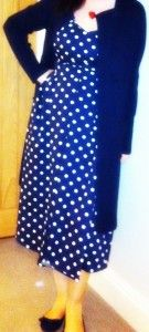 in navy blue polka dot cotton (this time I've ventured out and made the flared model)...
