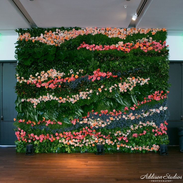 Stunning flower wall on Whim's boxwood hege using coral, pink and blushes shades of roses.  Just Happened!April 20th, 2016Such a great event last night celebrating The Knot and local wedding professionals. See below for beautiful moments and details by these awesome vendors who helped make it happen:Event Planner:  Posh EventsVenue:  South Congress…