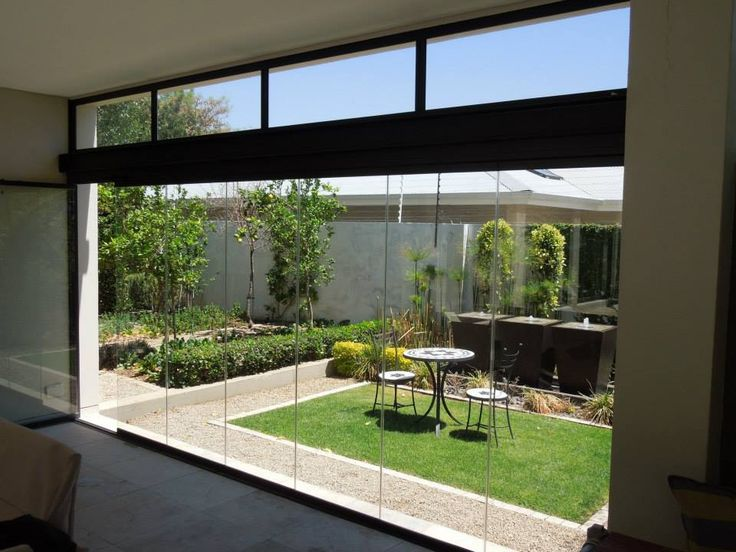 @sunflexsa The amazing frameless glass sliding doors lets you invite the outdoors in.