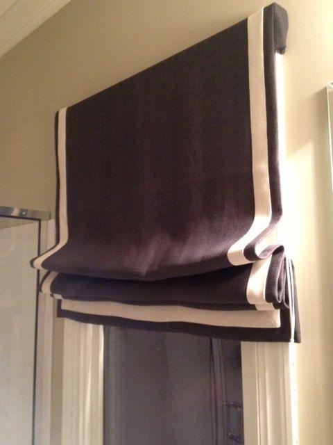 Custom made roman shade window treatment
