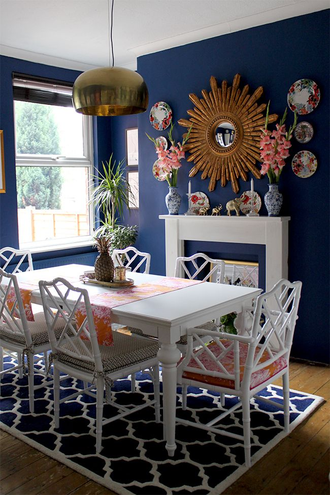 Dark Blue Dining Room With White Table And Faux Bamboo Chairs