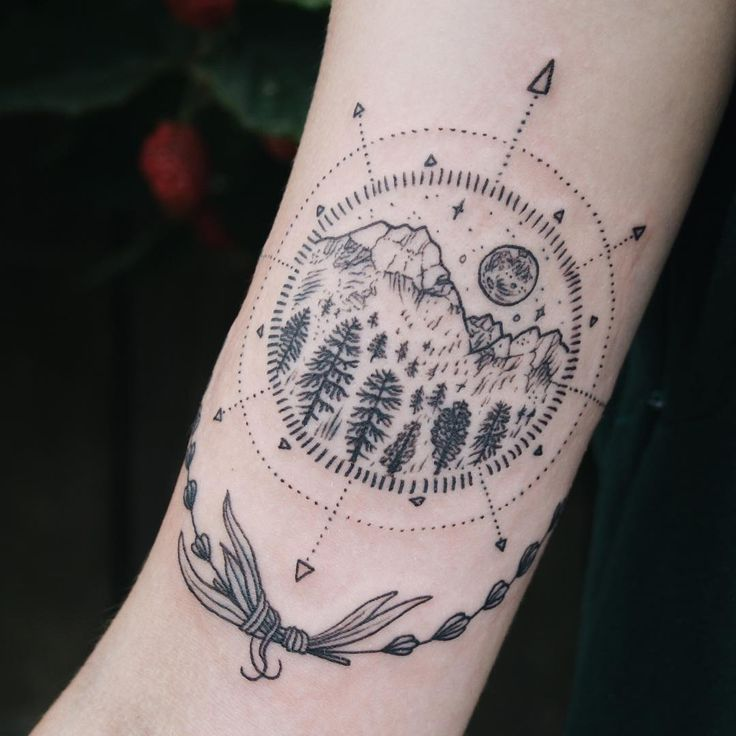 Tiny mountain, moon, evergreen compass with lavender on inner upper arm. Thanks Taija!