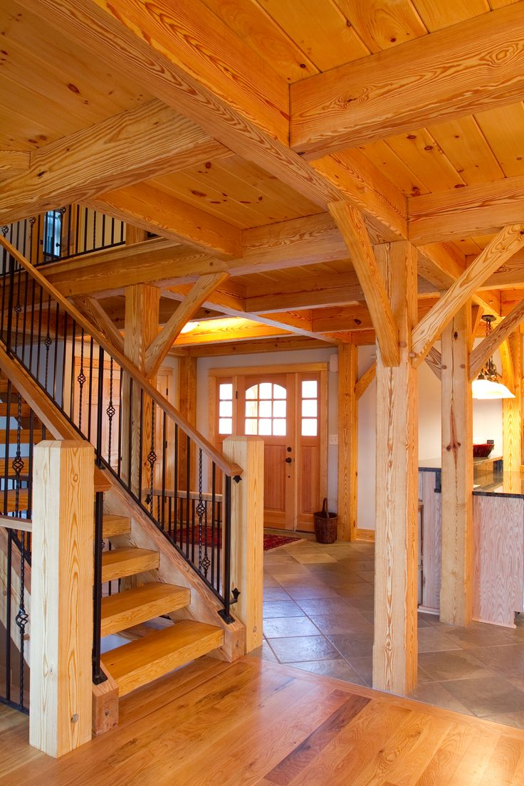 Beautiful woodhouse timber frame interior built by summit for Timber frame home interiors