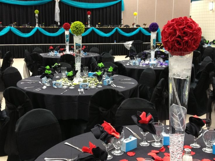 Who says you can't use black in your wedding?  This wedding used black and vivid pops of colour to create a magical effect.  Black chair covers and black organza sashes.
