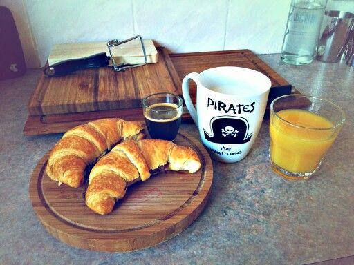 Breakfast. Colazione all'italiana. Nutella croissant. Milk. Coffe. Orange juice...have a nice day!