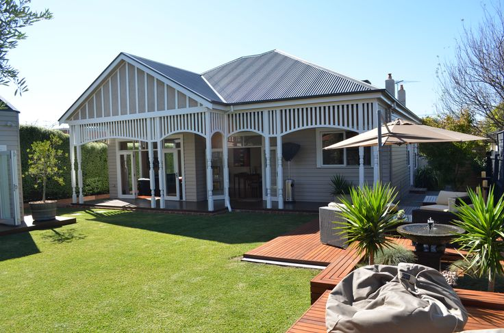 Traditional house renovation. Decking. Verandah. Outdoor living.  Backyard.  Grass.  Lawn. Landscaping. Neutral scheme.  Lisa Banducci Design.