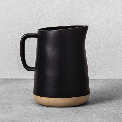 Add a bit of rustic flair to your kitchen drinkware with the Stoneware Pitcher from Hearth & Hand™ with Magnolia. In black, this simple stone pitcher is ideal for serving cold beverages like iced tea or lemonade to family and friends on a warm Sunday afternoon or as a decorative vase to display a beautiful floral arrangement or house plant. Mix and match with other kitchenware items from the Hearth & Hand with Magnolia collection to create your own custom set.<br><br...