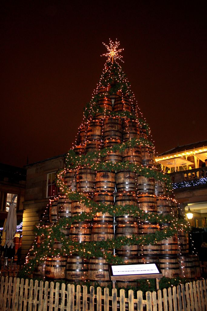 Jack Daniel's Barrel Christmas Tree, Covent Garden, London - This nine tier Christmas tree stand 26 feet  tall and contains 140 Jack Daniels whiskey barrel's.