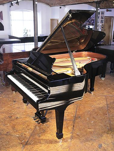 A 2013, Steinway Model B grand piano for sale with a black case and spade legs at Besbrode Pianos £75,000. Piano has an eighty-eight note keyboard and a three-pedal lyre.