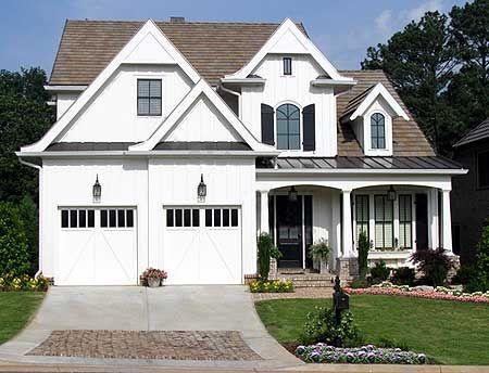 same floor plan with better exterior  (cream siding & light shutters)