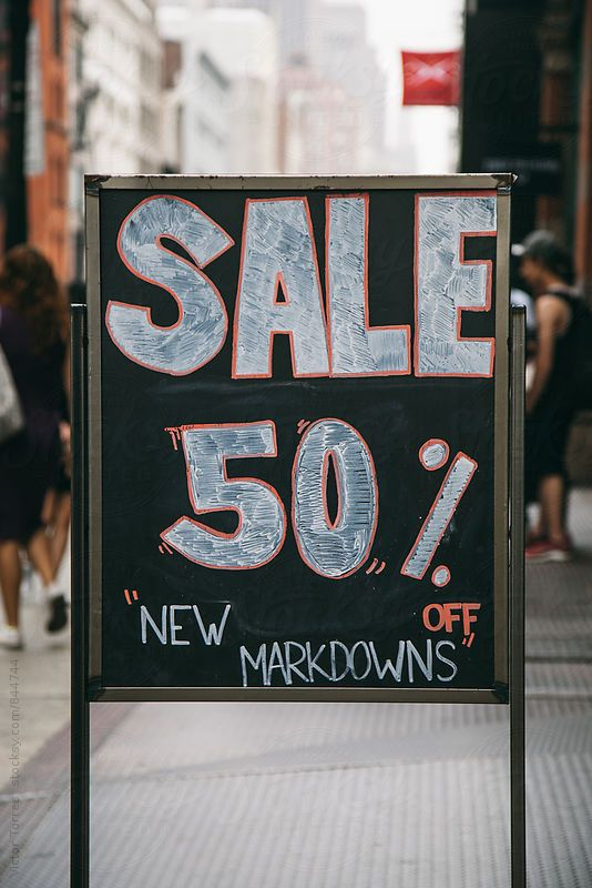 Store Chalkboard announcing Markdowns by Victor Torres for Stocksy United