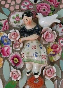 ceramic mosaic (detail), Rah Rivers...Ma...I thought this was pretty cool...the use of an actual whole figurine and flowers together. Very cool idea!