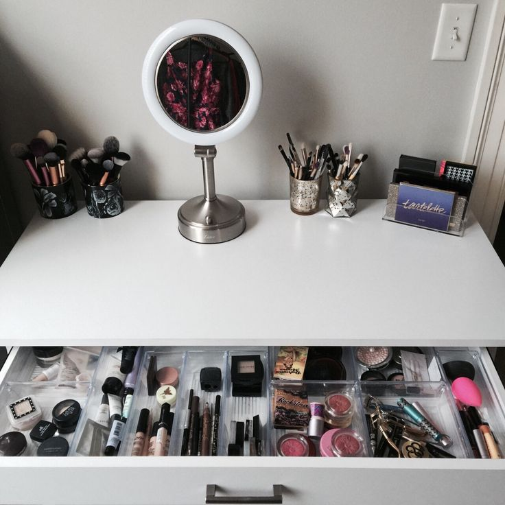 Divided drawer storage in a vanity keeps the makeup collection sorted