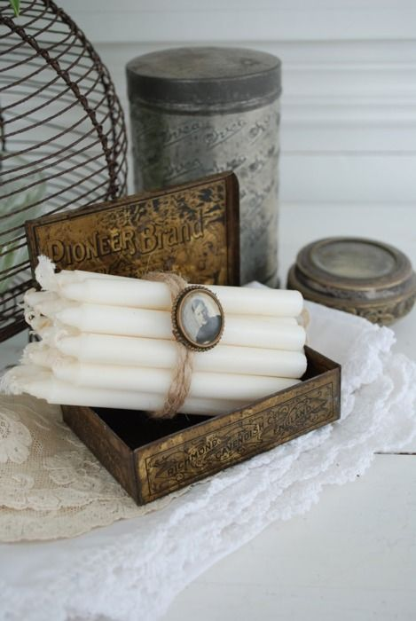 Candles in an old cigar box