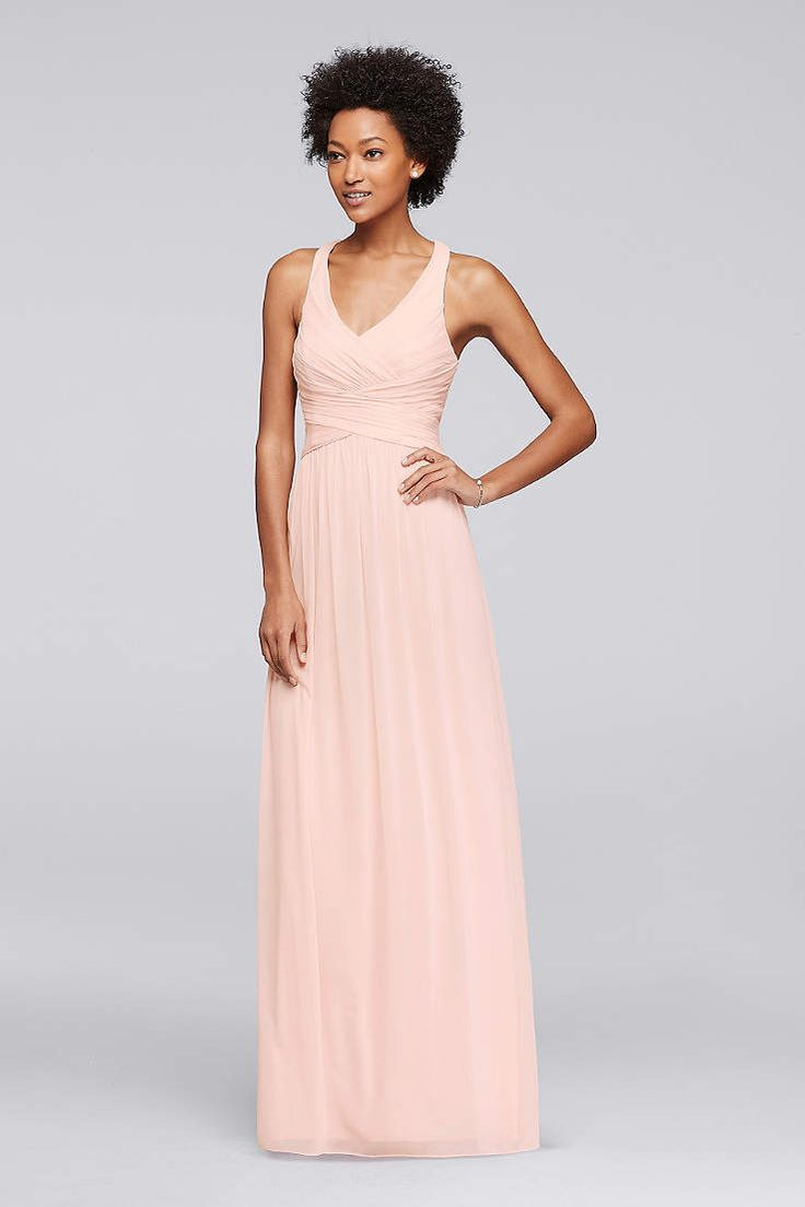 Beautiful This long mesh bridesmaid dress is a flattering option thanks to the fitted bodice V neckline and crisscross back straps fully lined Dry clean Imported