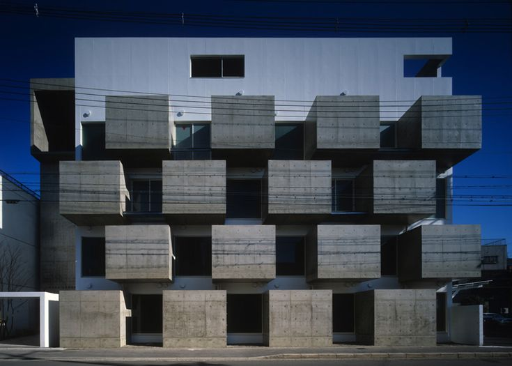 Chunky concrete boxes form a grid of secluded balconies across the facade of this apartment block in Kyoto by Japanese studio VIDZ Architects.