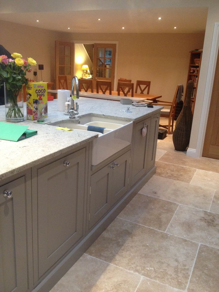 Large island unit with integrated dishwashers and Belfast sink. Finished in Farrow and Ball Dove Tale.