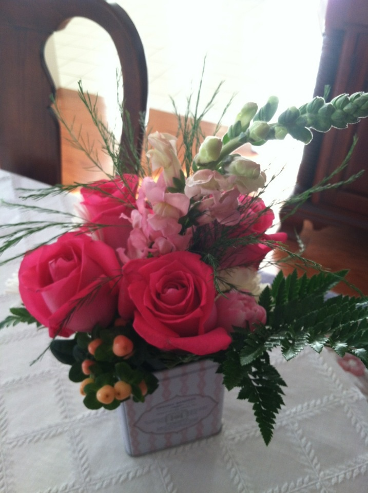 Baby shower idea: pink roses, snapdragons, and tulips with peach hypericum and leatherleaf fern