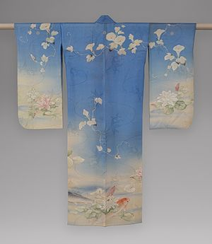 An antique kimono with carp, water lilies and morning glories, Meiji period, (1868-1912), circa 1876, Japan. Resist-dyed, painted, and embroidered silk gauze.