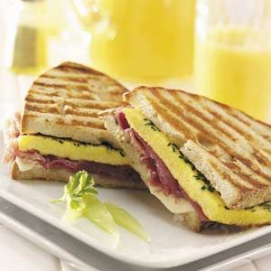 """Omelet Panini Recipe- Recipes  """"When you're in a hurry to get to work, this speedy breakfast recipe does the trick. The recipe makes two crispy, flavorful sandwiches,"""" notes Dorothy McClinton of North Chicago, Illinois."""