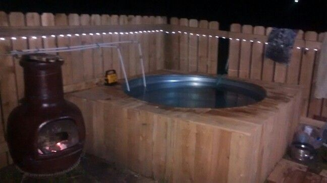 My home made six ft. Hot tub. Made with a stock tank and chiminea heater. Surrounded with cedar, the smell of cedar and burning pinion wood in the 104 degree water is a relaxing end to the day! A few details to finish still.