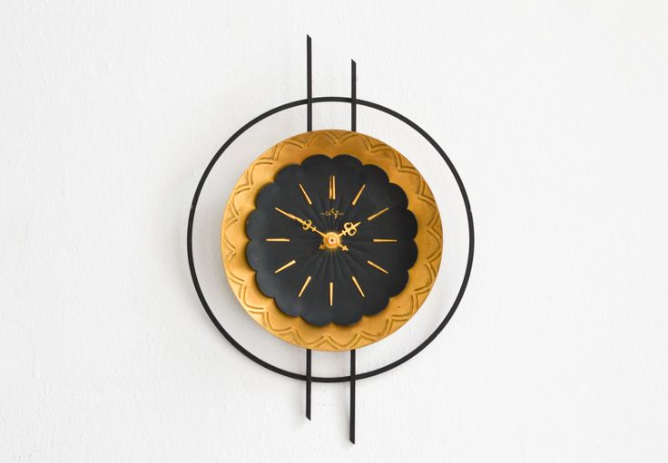 Vintage East German wall clock ebg GDR brass starburst sunburst Mid Century by MightyVintage on Etsy https://www.etsy.com/listing/263363636/vintage-east-german-wall-clock-ebg-gdr