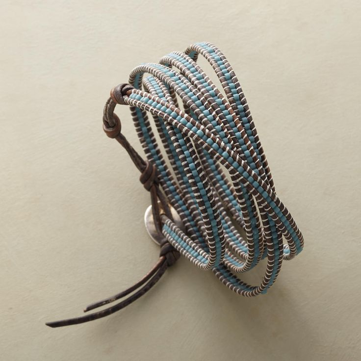 "BEST LOVED 5 WRAP BRACELET -- Faded blue, just like your best-loved jeans, winds its way in a slim, supple 5-wrap leather bracelet from designer Chan Luu. Adjustable button closure. 32""L."