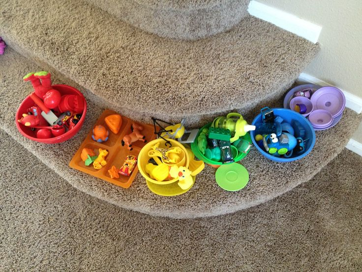 """COLORS: get containers of the """"color of the day"""" or of various colors and have child find toys that are that color and sort them into groups"""