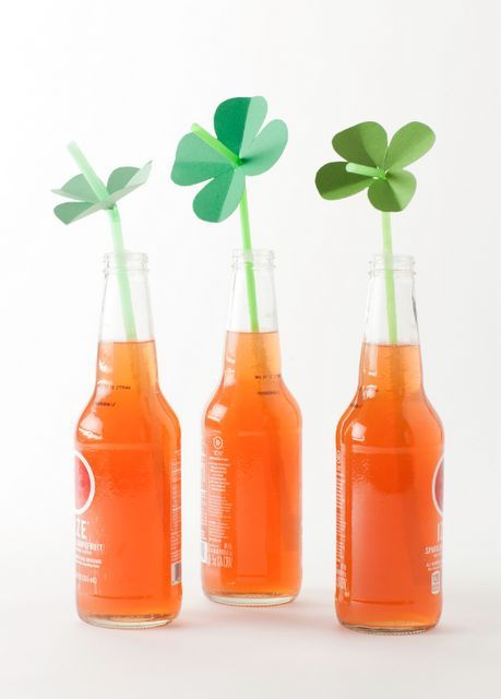 DIY Paper Shamrock Straw Toppers via Martha Stewart - Perfect for St. Patrick's Day Parties!