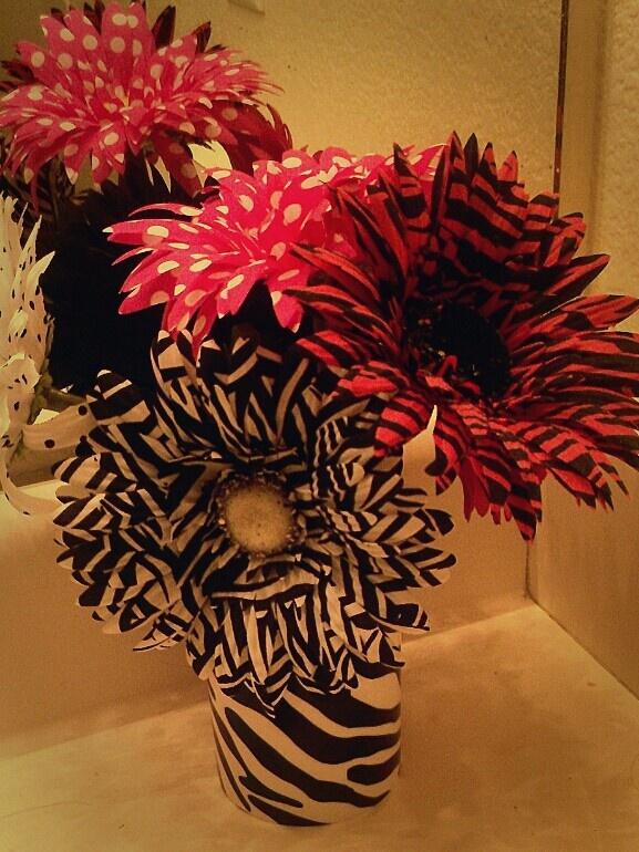 My bathroom.. theme, zebra stripes / punk daisy.. adorable flower decoration I put together :)