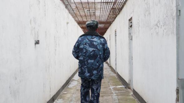 Prison Officer Walking in Inter Yard