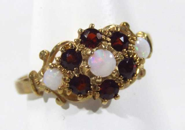Golding Young & Mawer Grantham : A ladies 9ct gold opal and garnet dress ring, florally : Online Auction Catalogue