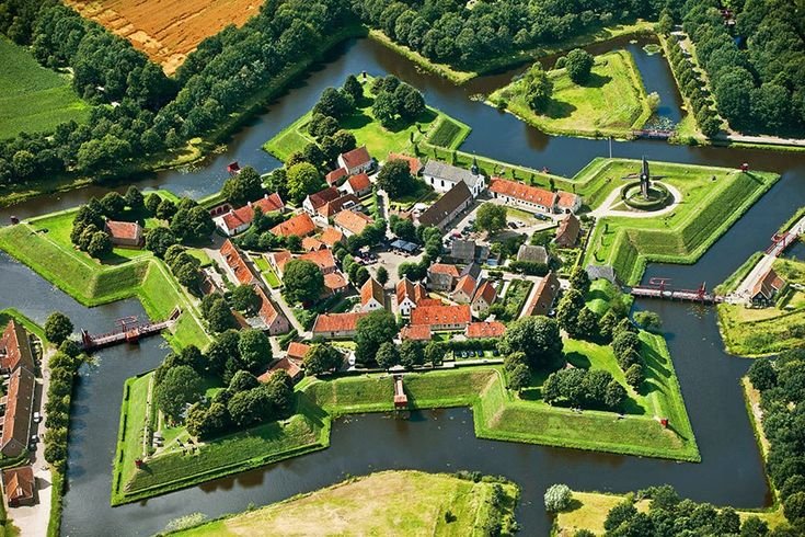 After serving as a military stronghold from 1593 to 1851, this star-shaped fortress was converted to civilian use—its geometric walls were lowered and its moats filled. In 2002, after a decades-long renovation, the verdant village was unveiled as a living history museum dedicated to the year 1742. The museum is complete with drawbridges, cannons, and a reconstructed stone mill.