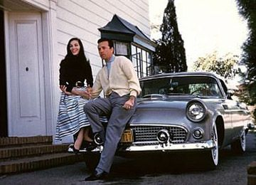 Vic Damone athome with their 1956 Ford Thunderbird March 15, 1957