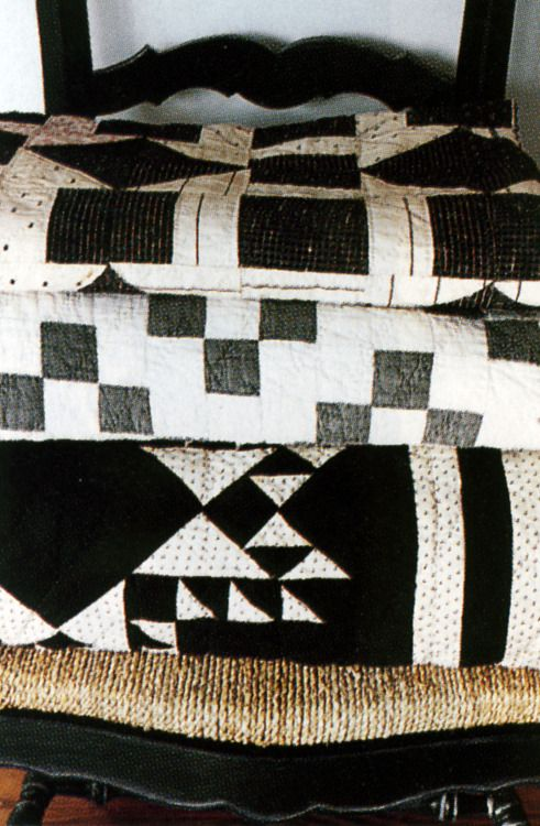 love black & white quilts - a reference to vintage aesthetics while the simple color palette allows them to fit in seamlessly with modern pieces