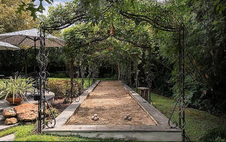 The prettiest Bocce ball court I have ever seen :: Wrought iron arbor is magnificent!