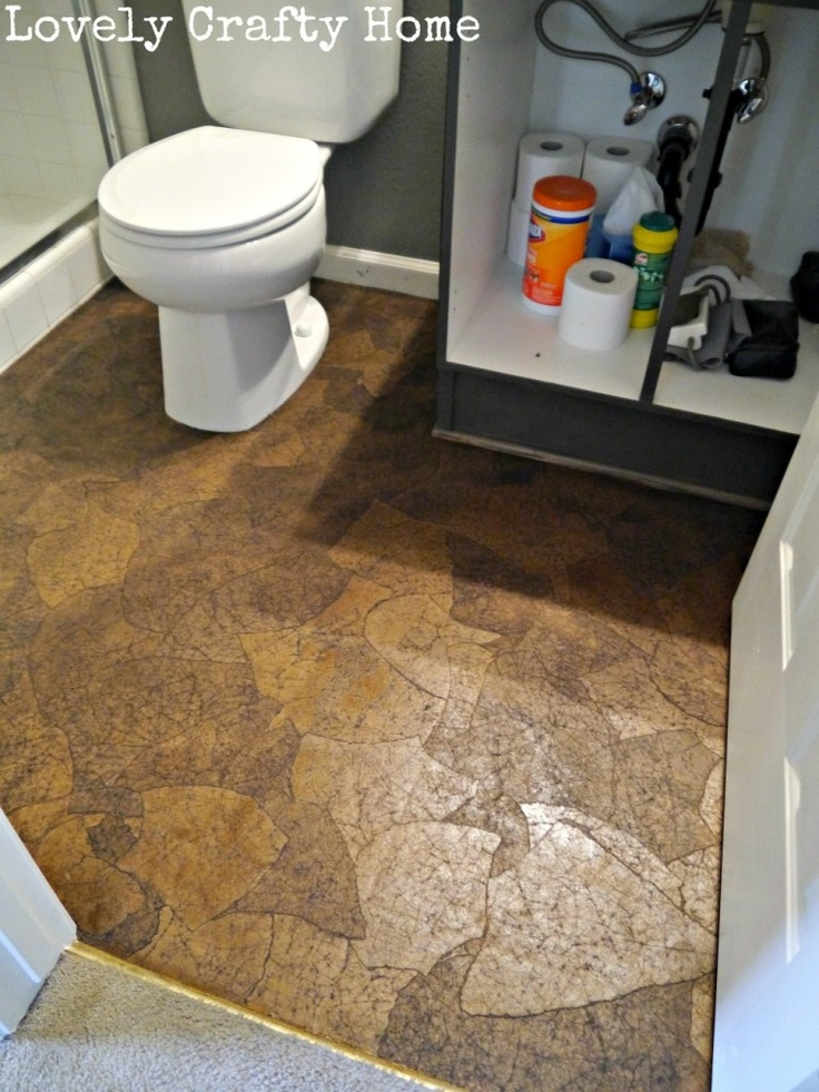 stained brown paper floor before poly-over vinyl flooring