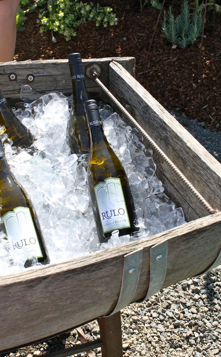 halved wine barrel as ice bucket! perfect!! love it! @Cara McFadyen This
