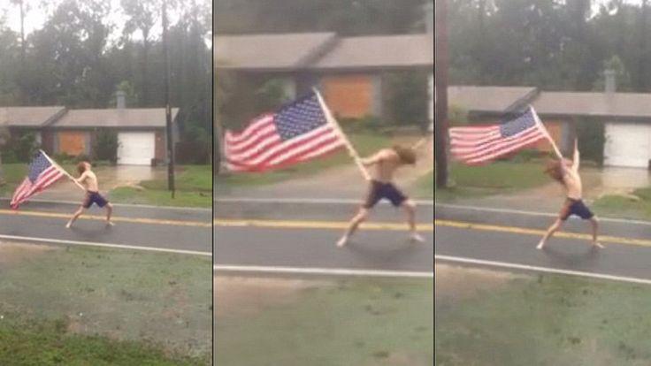 Video: Un joven semidesnudo 'desafía' al huracán Matthew con una bandera estadounidense - RT