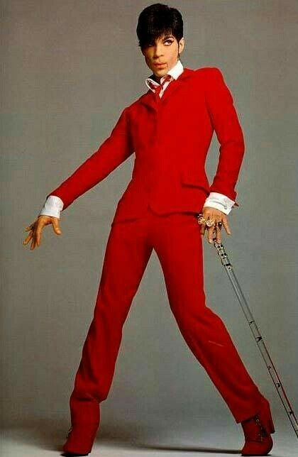 In red Versace suit
