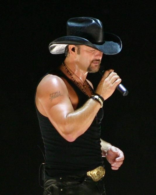 "Listen up guys, Tim McGraw is going on tour with Brantley Gilbert & Love & Theft. He will be in Chicago, Illinois May 24th. Tickets for Tim McGraw's Two Lanes of Freedom tour 2013 for the First Midwest Bank Amphitheatre in Chicago will start with presales for fan club members on Tuesday, February 5th at 10AM and on sale to the general public on Friday, February 8th at 10AM!""For more information check out http://timmcgraw.tumblr.com/ or http://www.timmcgraw.com/"