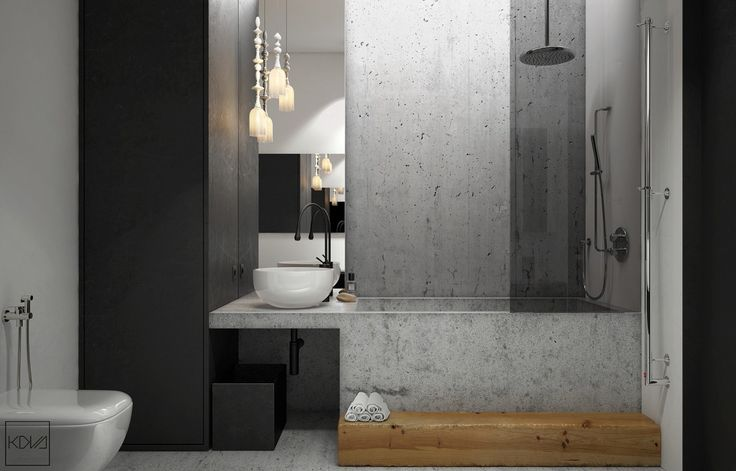 Multi-faceted granite panels and thick black cabinetry allude to extra space in the bathroom. An oblong, wooden bath step adds a central point of focus, while a hanging decorative light adds a touch of class.