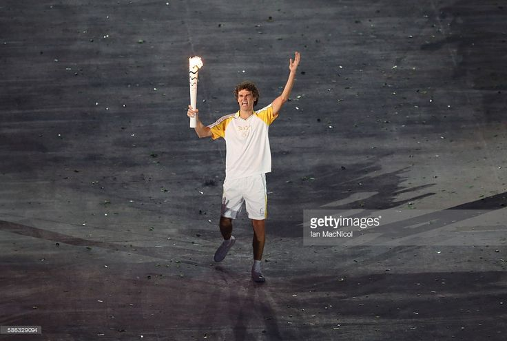 The Olympic flame is carried through the stadium during The 2016 Summer Olympics Opening Ceremony at Maracana Stadium on August 5, 2016 in Rio de Janeiro, Brazil.
