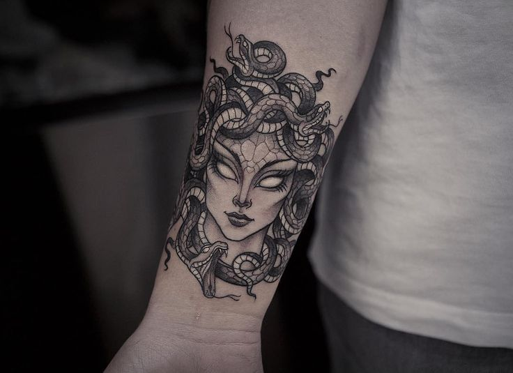 Black work head of Medusa Gorgona tattoo on forearm by lazerliz