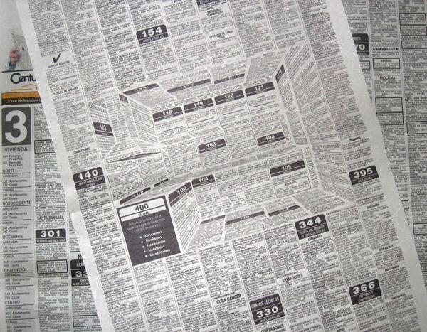 Clever 3-D Effect Newspaper Ad Hidden in the Classifieds