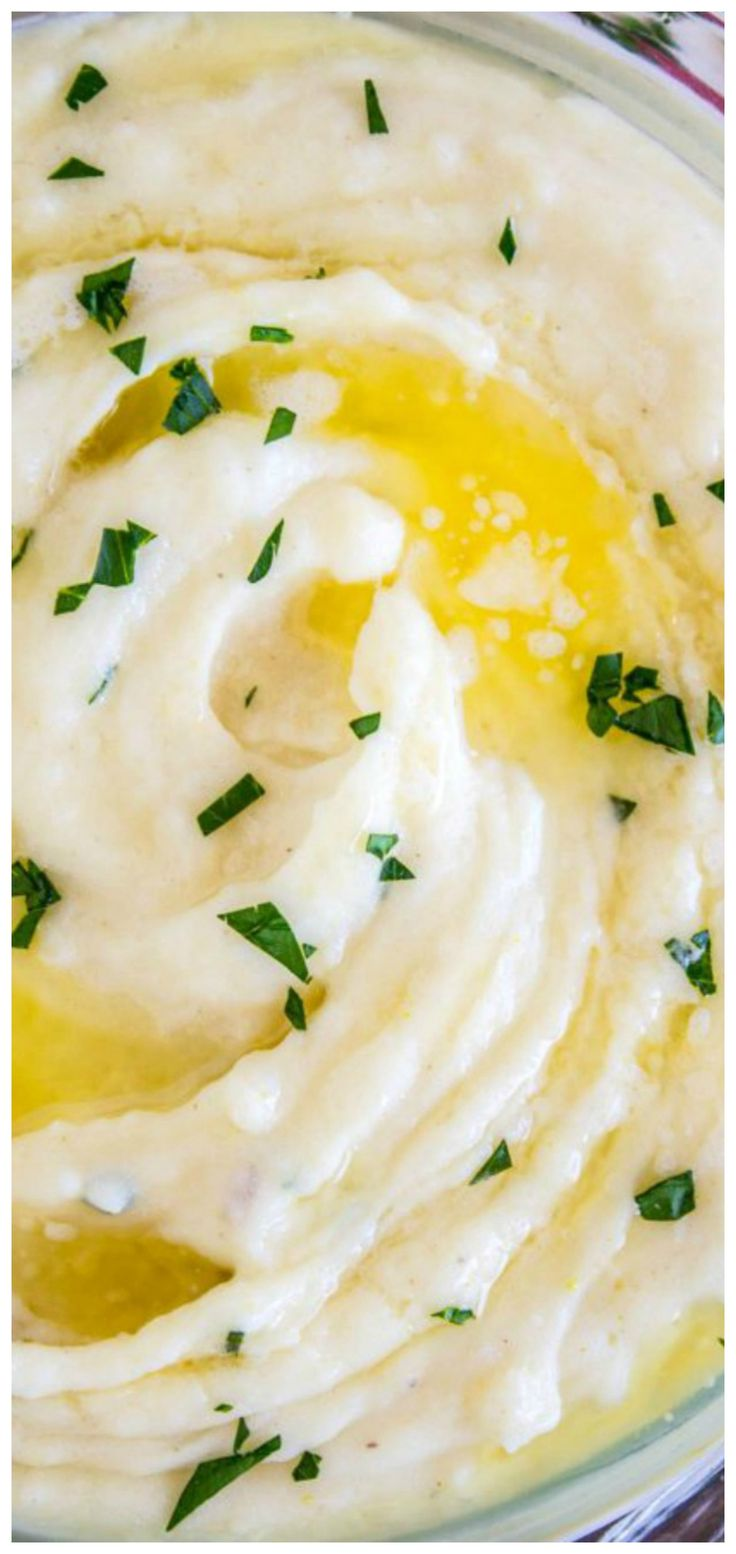 Aunt Shirley's Famous Creamy Mashed Potatoes ~ They are SO creamy, fluffy, and have TONS of flavor... They are like soft pillowy clouds that melt in your mouth.